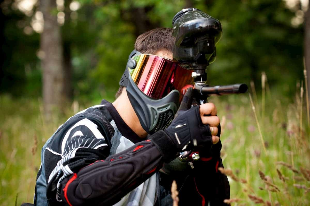 Paintball shooter in the field - What Do You Wear to go Paintballing