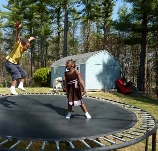 kids with socks on the backyard trampoline - What Are Trampoline Socks