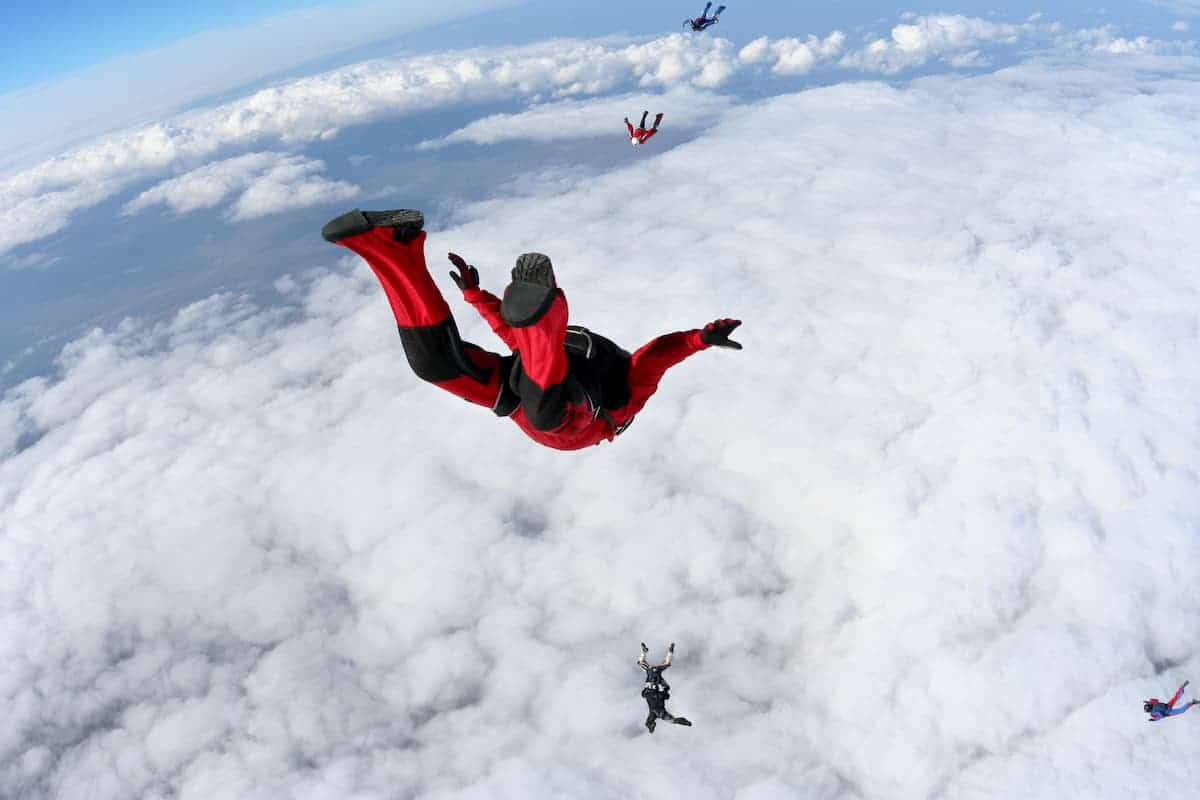 Skydiving down and into the clouds - post on How Much Does it Cost to Go Skydiving