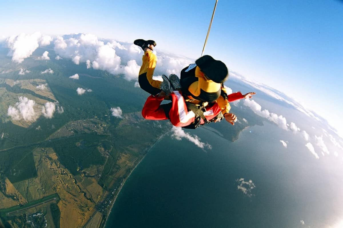 Woman Skydiving over New Zealand - post on What is Tandem Skydiving