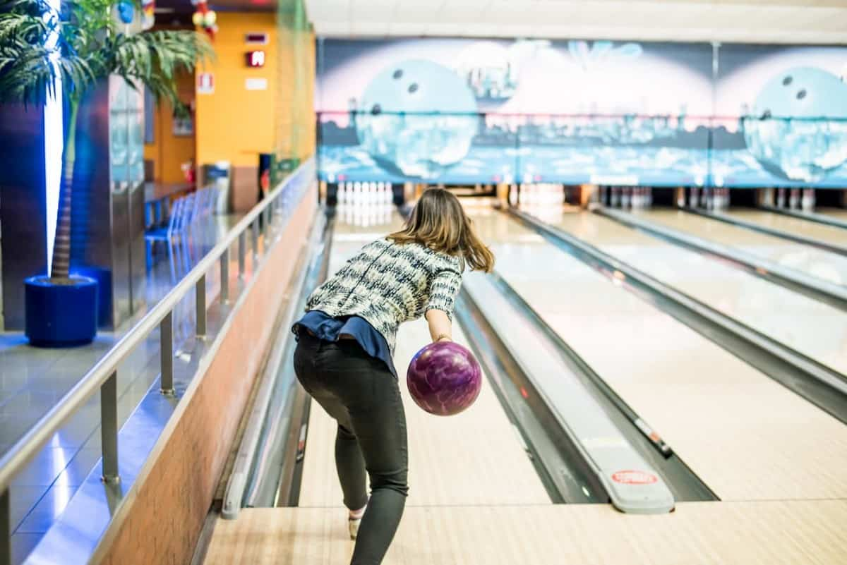 Young pretty girl having fun and enjoying herself while bowling - Is Bowling a Sport