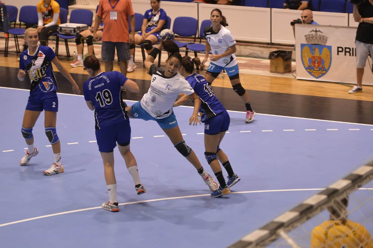 Female handball player, Ana Paula Rodrigues, throwing the ball during the game between her team, CSM Bucuresti from Romania and Muratpasa Belediyesi Antalya from Turkey at Bucharest Trophy